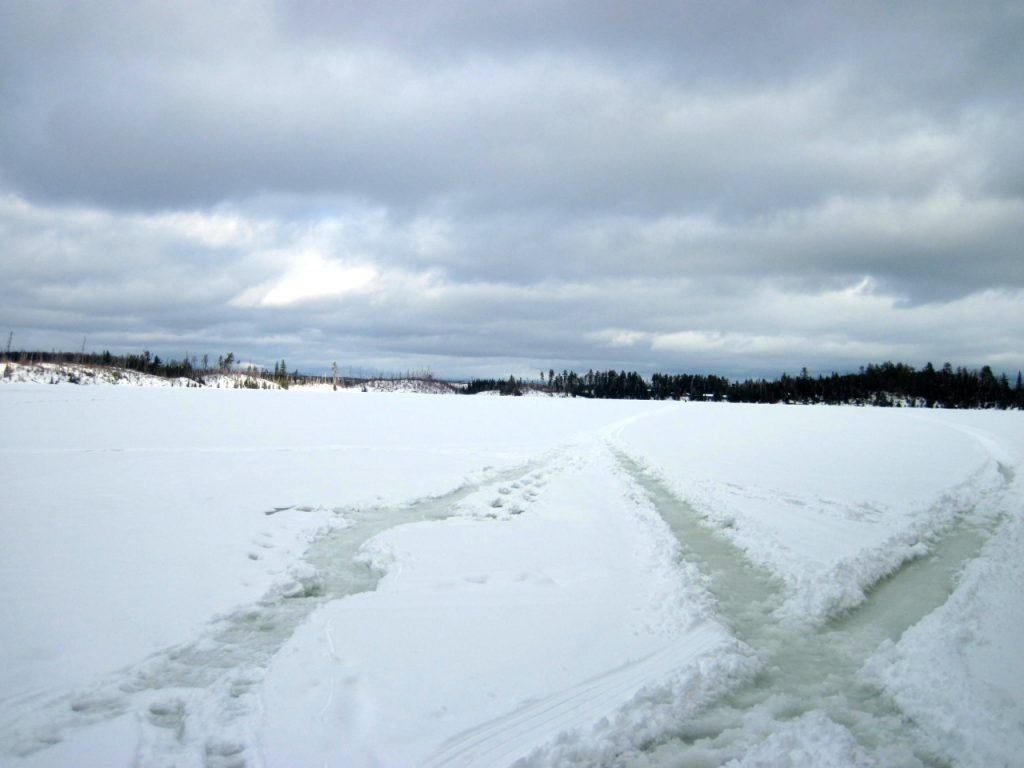 Slush Trails from winter campers and snowmobiles on Round Lake on the Gunflint Trail in MN
